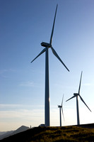 Three recently-installed windmills provide half....
